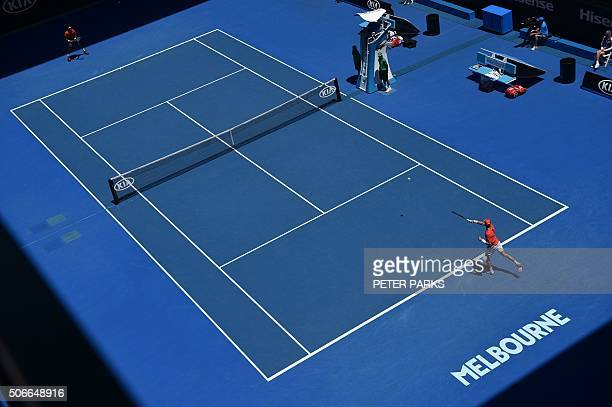 TOPSHOT Russia's Andrey Kuznetsov plays a forehand return during his men's singles match against France's Gael Monfils on day eight of the 2016...