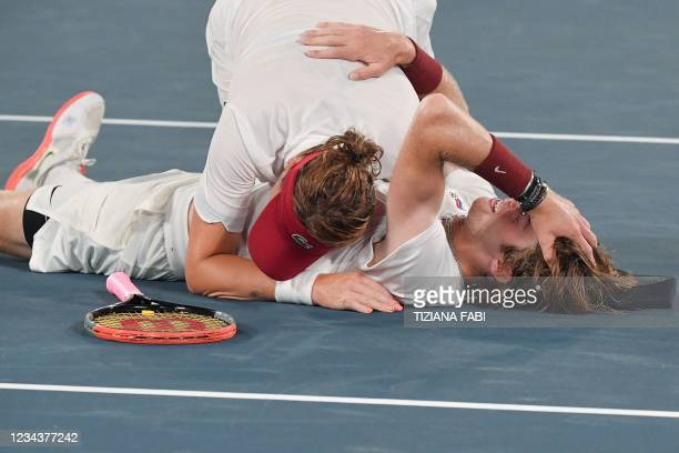 Russia's Andrey Rublev and Russia's Anastasia Pavlyuchenkova celebrate after winning the Tokyo 2020 Olympic mixed doubles tennis final match at the...