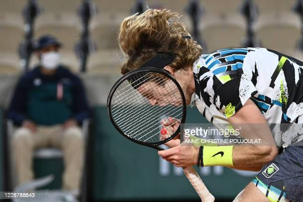 Russia's Andrey Rublev celebrates after winning against Sam Querrey of the US at the end of their men's singles first round tennis match at the...
