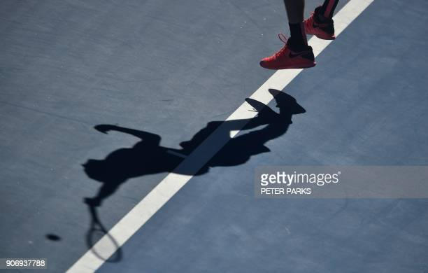 Russia's Andrey Rublev hits a return against Bulgaria's Grigor Dimitrov during their men's singles third round match on day five of the Australian...