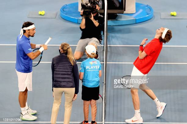 Russia's Andrey Rublev laughs on a joke during a match toss against Italy's Fabio Fognini during their ATP Cup men's singles final tennis match in...