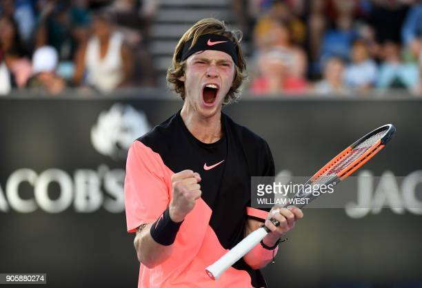 Russia's Andrey Rublev reacts after a point against Cyprus' Marcos Baghdatis during their men's singles second round match on day three of the...