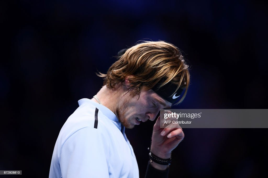 Russia's Andrey Rublev reacts as he plays against South Korea's Hyeon Chung during their men's singles final tennis match during the Next Generation ATP Finals in Milan on November 11, 2017. /