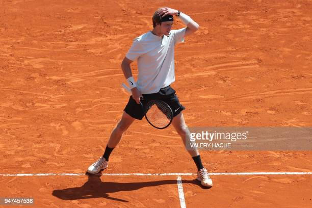 Russia's Andrey Rublev reacts during his tennis match against Austria's Dominic Thiem as part of the MonteCarlo ATP Masters Series Tournament on...