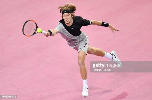 Russia's Andrey Rublev returns the ball to France's JoWilfried Tsonga during their quarterfinal singles tennis match at the Open Sud de France ATP...