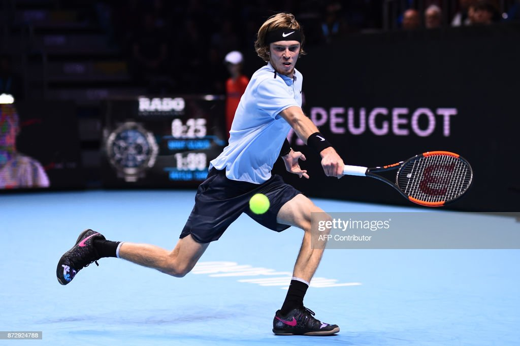 Russia's Andrey Rublev returns the ball to South Korea's Hyeon Chung during their men's singles final tennis match during the Next Generation ATP Finals in Milan on November 11, 2017. /