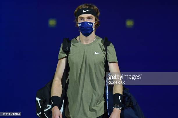 Russia's Andrey Rublev wearing a protective face covering to combat the spread of the coronavirus, arrives to play against Austria's Dominic Thiem in...