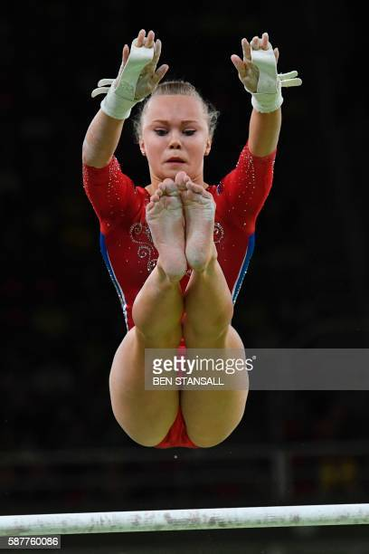 Russia's Angelina Melnikova competes in the Uneven Bars event during the women's team final Artistic Gymnastics at the Olympic Arena during the Rio...