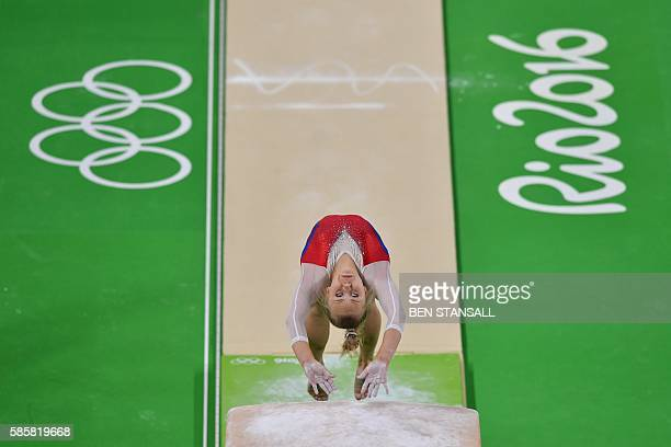 Russia's Angelina Melnikova practices on the vault of the women's Artistic gymnastics at the Olympic Arena on August 4 2016 ahead of the Rio 2016...