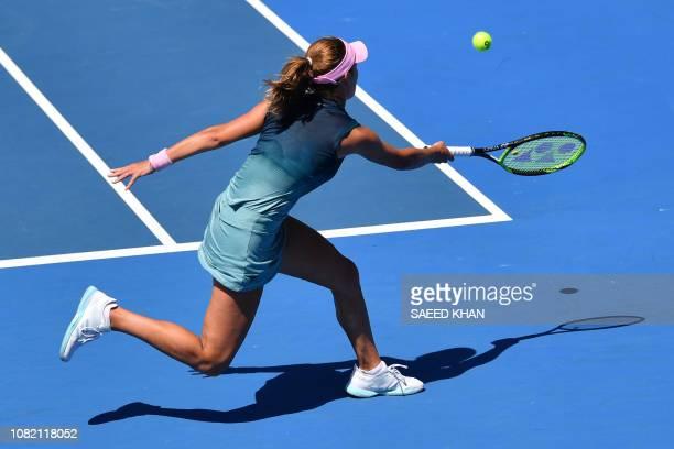 Russia's Anna Kalinskaya hits a return against Belarus' Aryna Sabalenka on day one of the Australian Open tennis tournament in Melbourne on January...