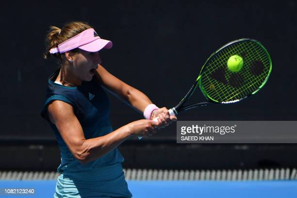 Russia's Anna Kalinskaya hits a return against Belarus' Aryna Sabalenka during their women's singles match on day one of the Australian Open tennis...