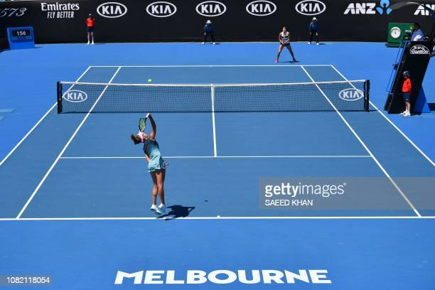 Russia's Anna Kalinskaya serves against Belarus' Aryna Sabalenka on day one of the Australian Open tennis tournament in Melbourne on January 14 2019...