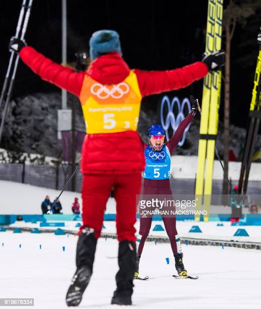 Russia's Anna Nechaevskaya celebrates with her teammates after the women's 4x5km classic free style cross country relay at the Alpensia cross country...