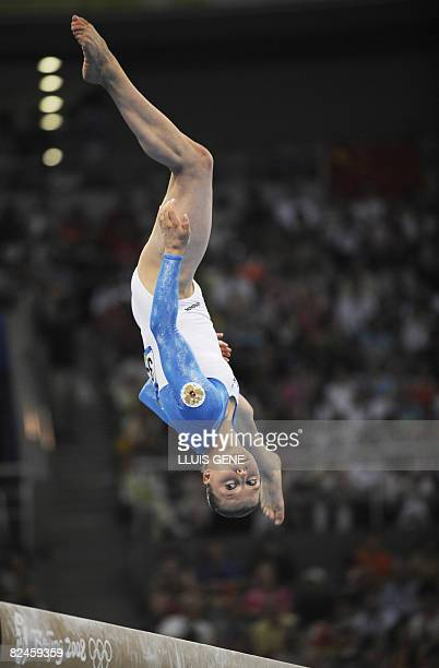 Russia's Anna Pavlova competes in the women's balance beam final of the artistic gymnastics event of the Beijing 2008 Olympic Games in Beijing on...