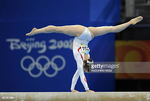 Russia's Anna Pavlova competes on the balance beam during the women's team final of the artistic gymnastics event of the Beijing 2008 Olympic Games...