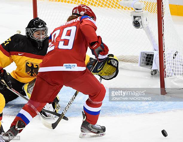Russia's Anna Shokhina misses a shot against Germany's goalkeeper Viona Harrer during the Women's Ice Hockey Group B match Russia vs Germany at the...