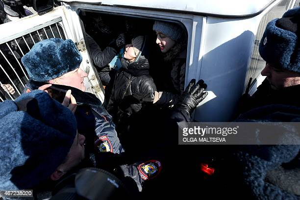 Russia's antifascists activists are arrested by policemen after holding a protest near the venue of the International Russian Conservative Forum in...