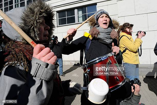 Russia's antifascists activists hold a protest near the venue of the International Russian Conservative Forum in SaintPetersburg on March 22 2015...