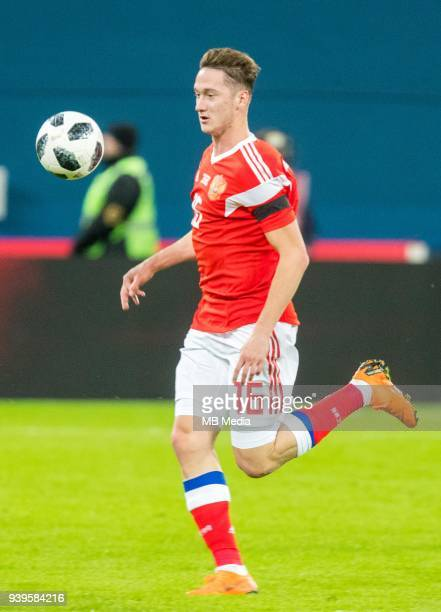 Russia's Anton Miranchuk looks the ball during the International friendly football match at Saint Petersburg Stadium on March 27 2018 in...