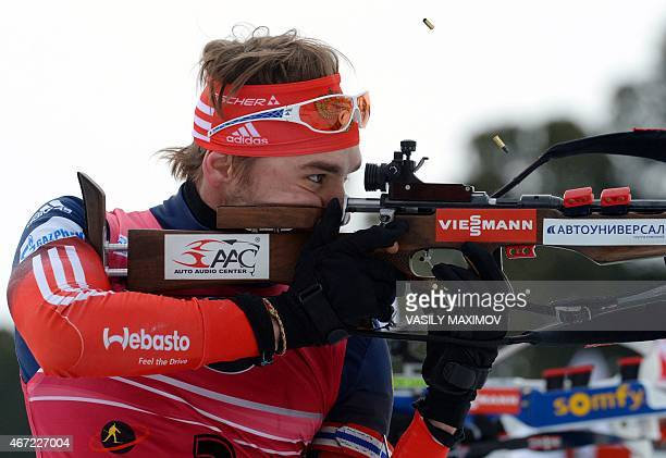 Russia's Anton Shipulin competes at the shooting range during the men's 15 km mass start event of the IBU Biathlon Word Cup in the Siberian city of...
