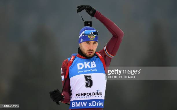 Russia's Anton Shipulin gets ready for the warmup shooting prior the men's 15 kilometer mass start competition at the Biathlon World Cup on January...