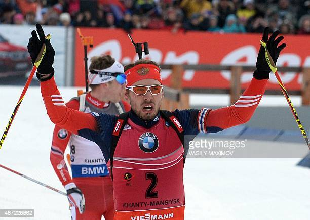 Russia's Anton Shipulin reacts as he crosses the finish line to place second in the men's 15 km mass start event of the IBU Biathlon Word Cup in the...