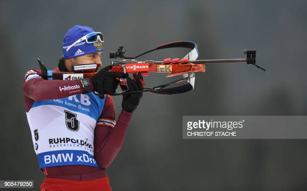 Russia's Anton Shipulin shoots during the warmup shooting prior the men's 15 kilometer mass start competition at the Biathlon World Cup on January 14...