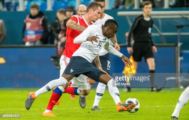 Russia's Anton Zabolotny and France's Blaise Matuidi fight for the ball during the International friendly football match at Saint Petersburg Stadium...
