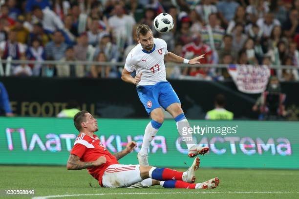 Russia's Anton Zabolotny and Radim Reznik of the Czech Republic vie for the ball during the international friendly football match between Russia and...