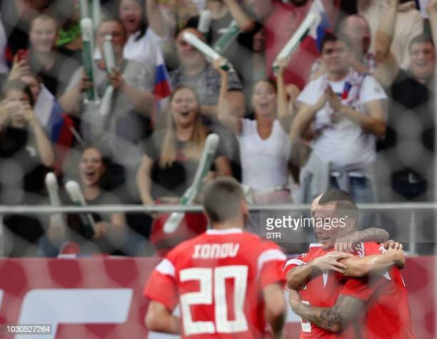Russia's Anton Zabolotny celebrates with teammates after scoring the team's second goal during the international friendly football match between...