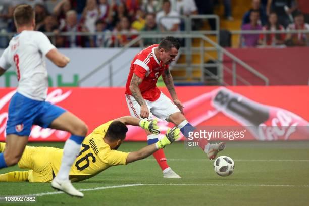 Russia's Anton Zabolotny scores the team's second goal past goalkeeper Tomas Koubek of the Czech Republic during the international friendly football...