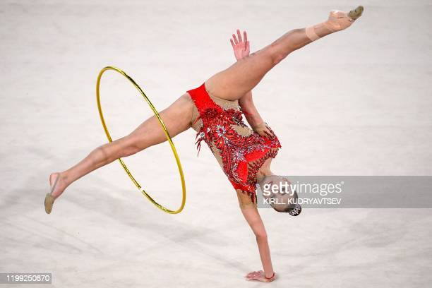 Russia's Arina Averina competes in the hoop event of the Rhythmic Gymnastics Alina Kabaeva Champions Cup in Moscow on February 7, 2020.