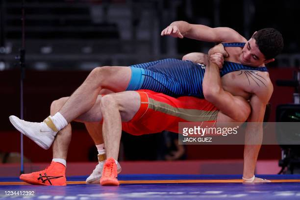 Russia's Artem Surkov wrestles USA's Alejandro Sancho in their men's greco-roman 67kg wrestling early round match during the Tokyo 2020 Olympic Games...