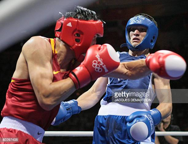 Russia's Artur Beterbiev fights against China's Xiaoping Zhang during their 2008 Olympic Games Light Heavyweight boxing bout on August 14 2008 in...