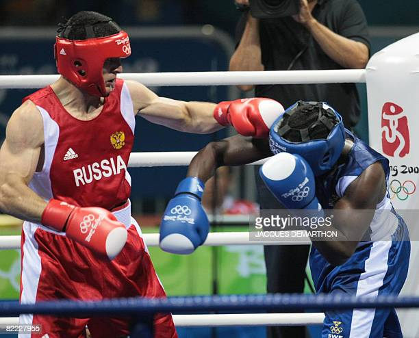 Russia's Artur Beterbiev fights against Sweden's Kennedy Katende during their 2008 Olympic Games Light Heavyweight boxing bout on August 09 2008 in...