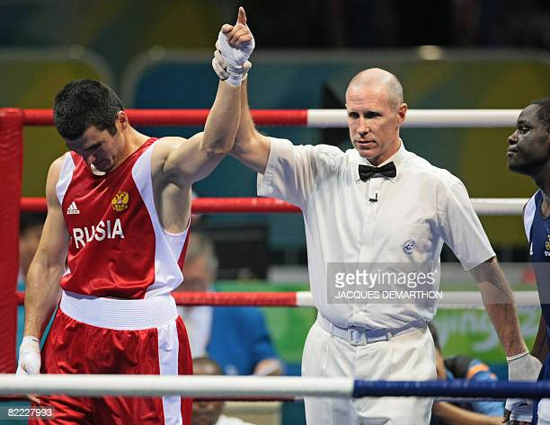 Russia's Artur Beterbiev is declared winner after defeating Sweden's Kennedy Katende during their 2008 Olympic Games Light Heavyweight boxing bout on...