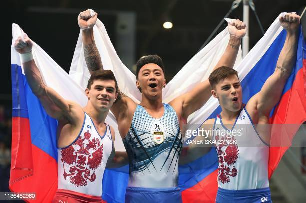 Russia's Artur Dalaloyan Cyprus' Marios Georgiou and Russia's Nikita Nagornyy celebrate after the Men's AllAround final during the Artistic...