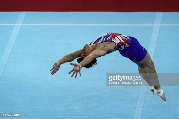 TOPSHOT Russia's Artur Dalaloyan performs on the floor during the mens team final at the FIG Artistic Gymnastics World Championships at the...