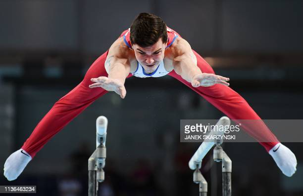 TOPSHOT Russia's Artur Dalaloyan performs on the parallel bars during the Men's AllAround final during the Artistic Gymnastics Championships in...