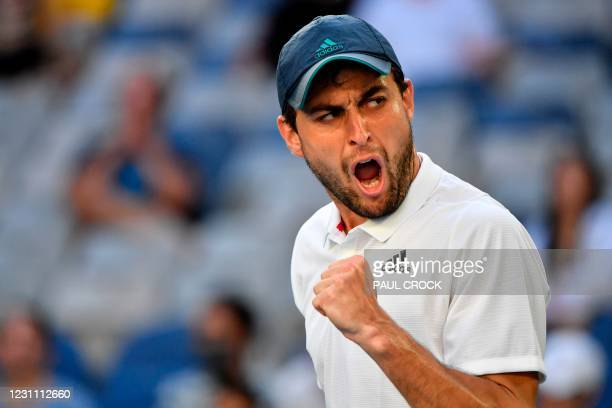 Russia's Aslan Karatsev celebrates a point against Argentina's Diego Schwartzman during their men's singles match on day five of the Australian Open...