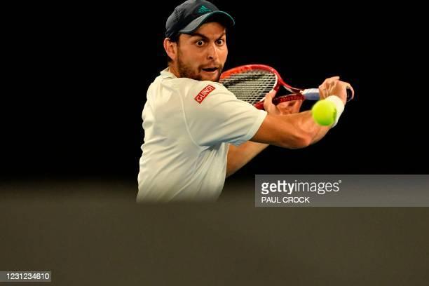 Russia's Aslan Karatsev hits a return against Serbia's Novak Djokovic during their men's singles semi-final match on day eleven of the Australian...