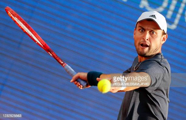 Russia's Aslan Karatsev plays a forehand return to Italy's Matteo Berrettini during their ATP 250 Serbia Open final tennis match at The Novak Tennis...