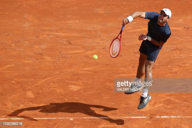 Russia's Aslan Karatsev returns the ball to Greece's Stefanos Tsitsipas during their second round singles match on day three of the Monte-Carlo ATP...