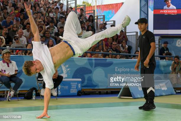 Russia's bboy Bumblebee competes against Japan's bboy Shigelix during a battle at the Youth Olympic Games in Buenos Aires Argentina on October 08...