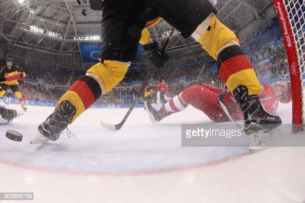 Russia's Bogdan Kiselevich lies on the ice in the men's gold medal ice hockey match between the Olympic Athletes from Russia and Germany during the...