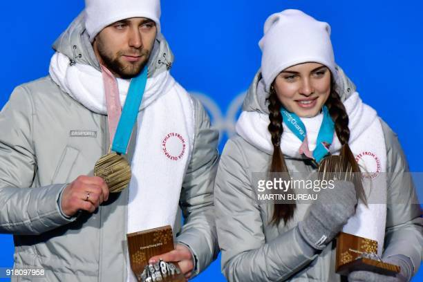 Russia's bronze medallist Anastasia Bryzgalova and Aleksandr Krushelnitckii pose on the podium during the medal ceremony for the curling mixed...