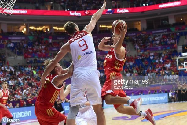 Russia's center Dmitry Khvostov tries to shoot past Turkey's center Semih Erden during the FIBA Eurobasket 2017 men's group D basketball match...