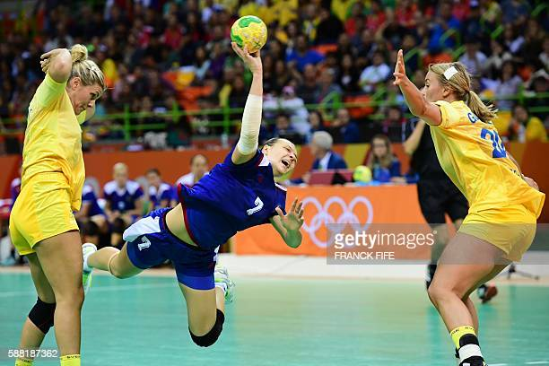 Russia's centre back Daria Dmitrieva jumps to shoot past Sweden's centre back Isabelle Gullden during the women's preliminaries Group A handball...