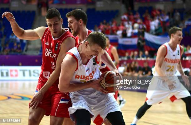 Russia`s centre Timofey Mozgov fights for the ball with Serbia`s Dragan Milosavljevic during the FIBA Eurobasket 2017 men`s group D basketball match...