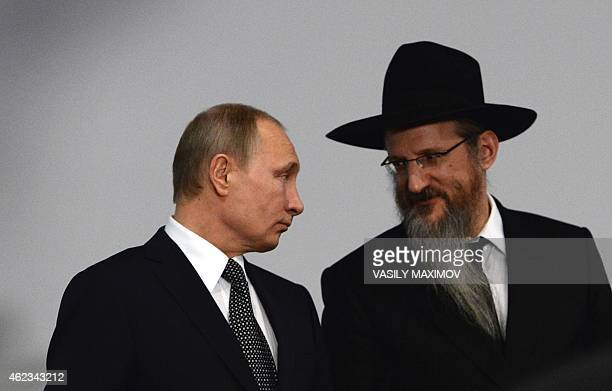 Russia's chief rabbi Berel Lazar talks with Russian President Vladimir Putin at the Jewish Museum in Moscow on January 27 2015 Putin on January 27...